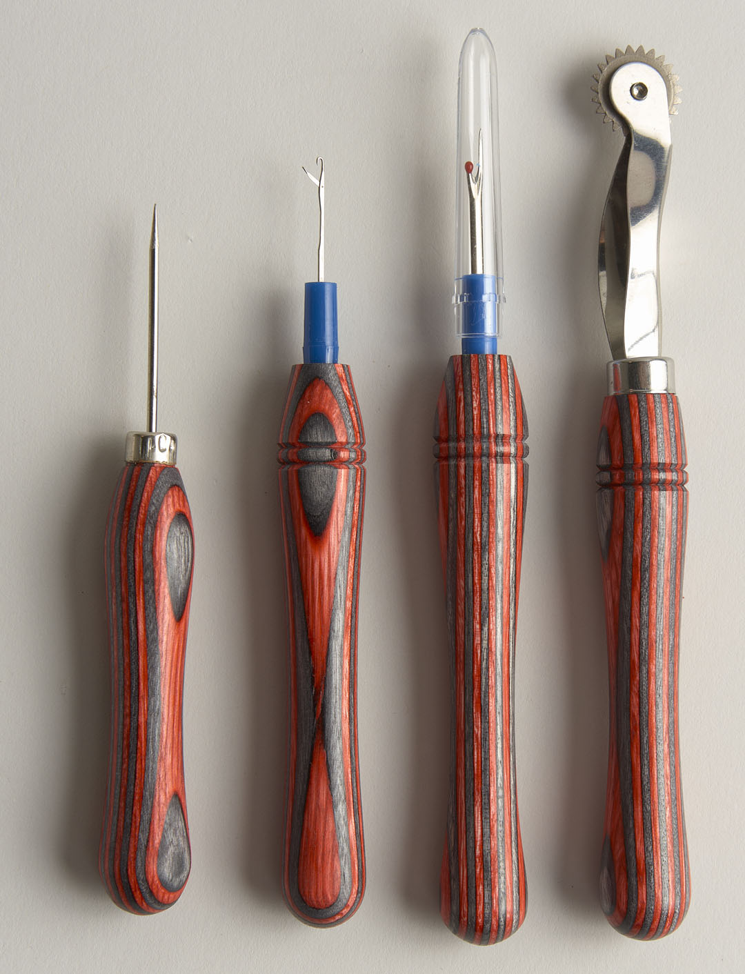Hand-turned wooden sewing tools