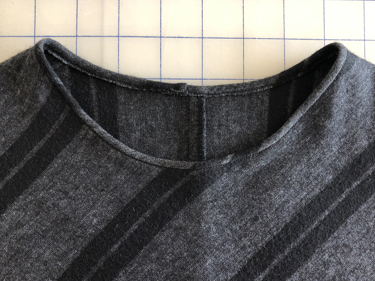 Knit top with neck binding