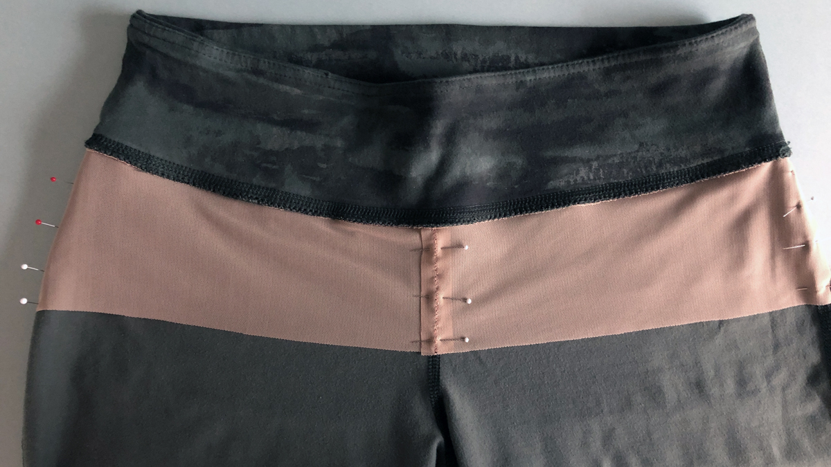 Pin the power net in place at the center and sides of the pants