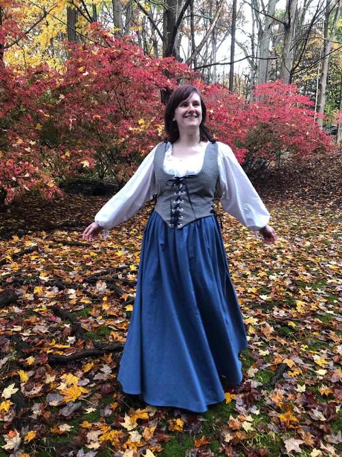 Woman in fall-like setting wearing period costume