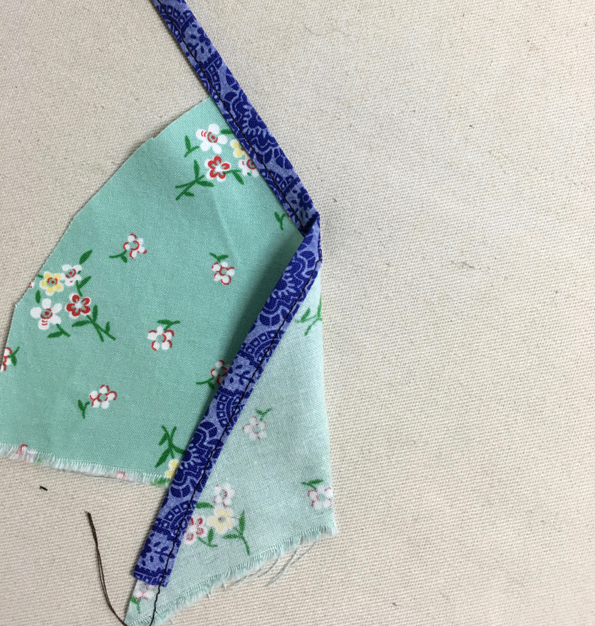 Sewn bias binding on a piece of color fabric