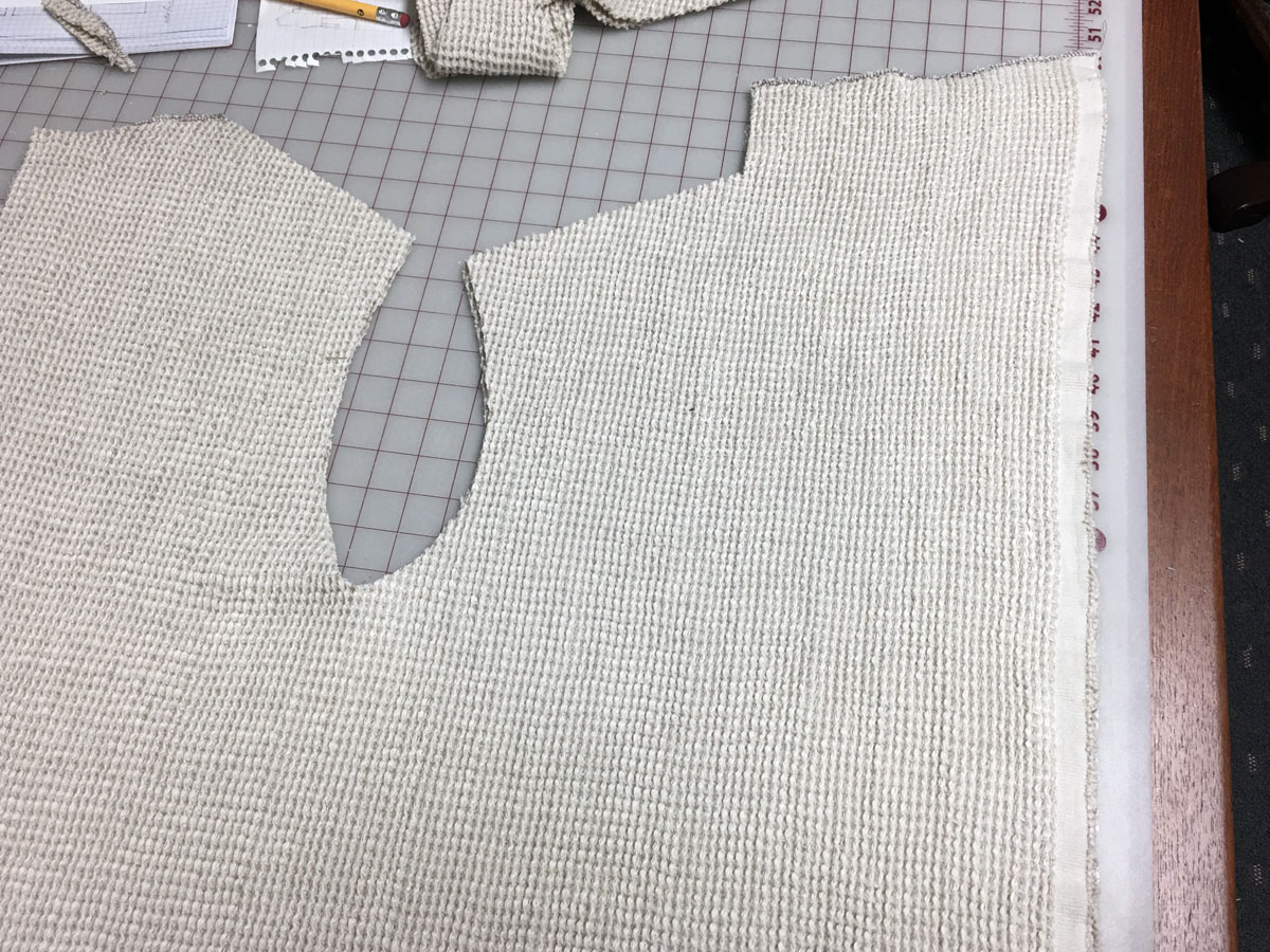 Sewing self-care: Waffle weave linen yardage is cut into front and back sections for a bathrobe
