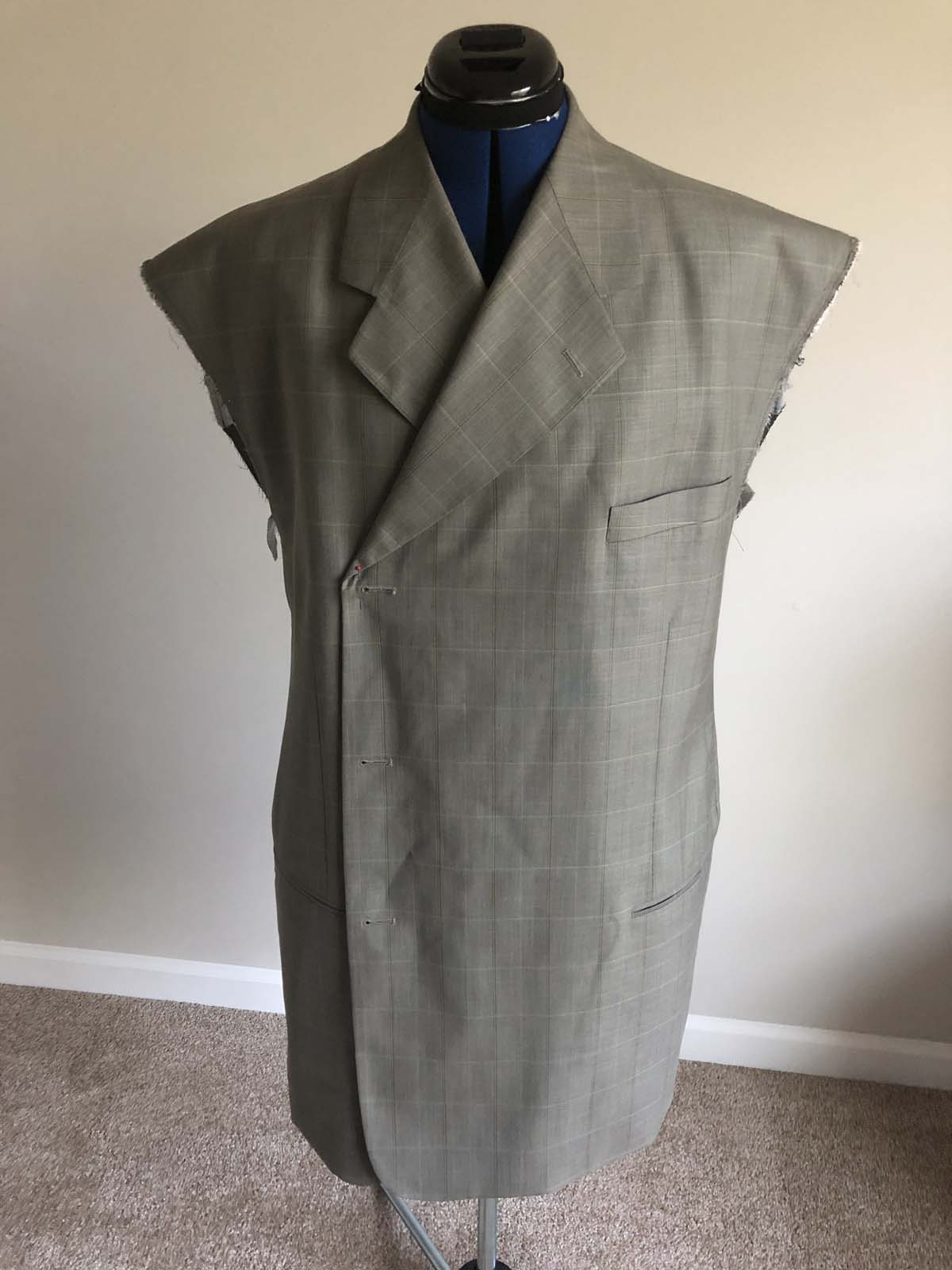 check the fit of the jacket before adjusting the lining