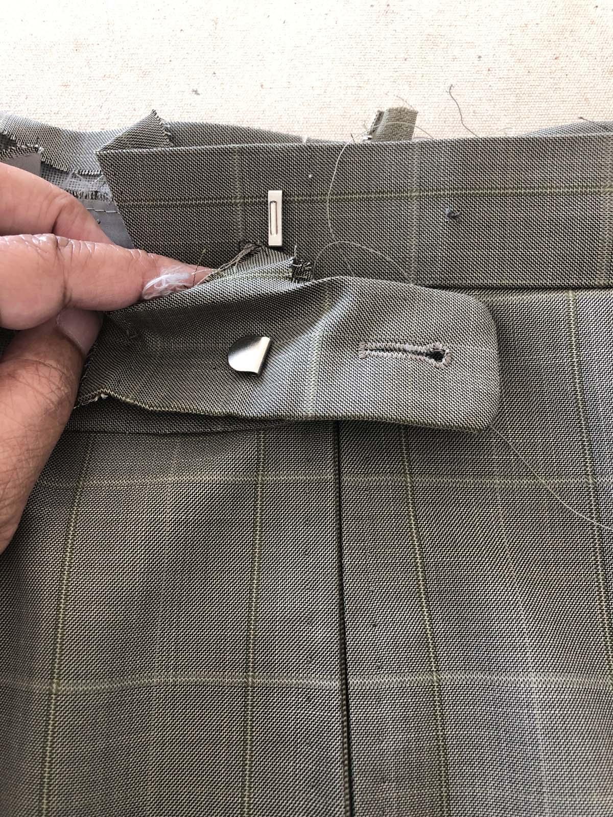 Close-up of men's suit pants waistband back with original closure