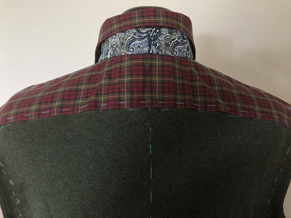 Appliqued red plaid shirt collar band, back view