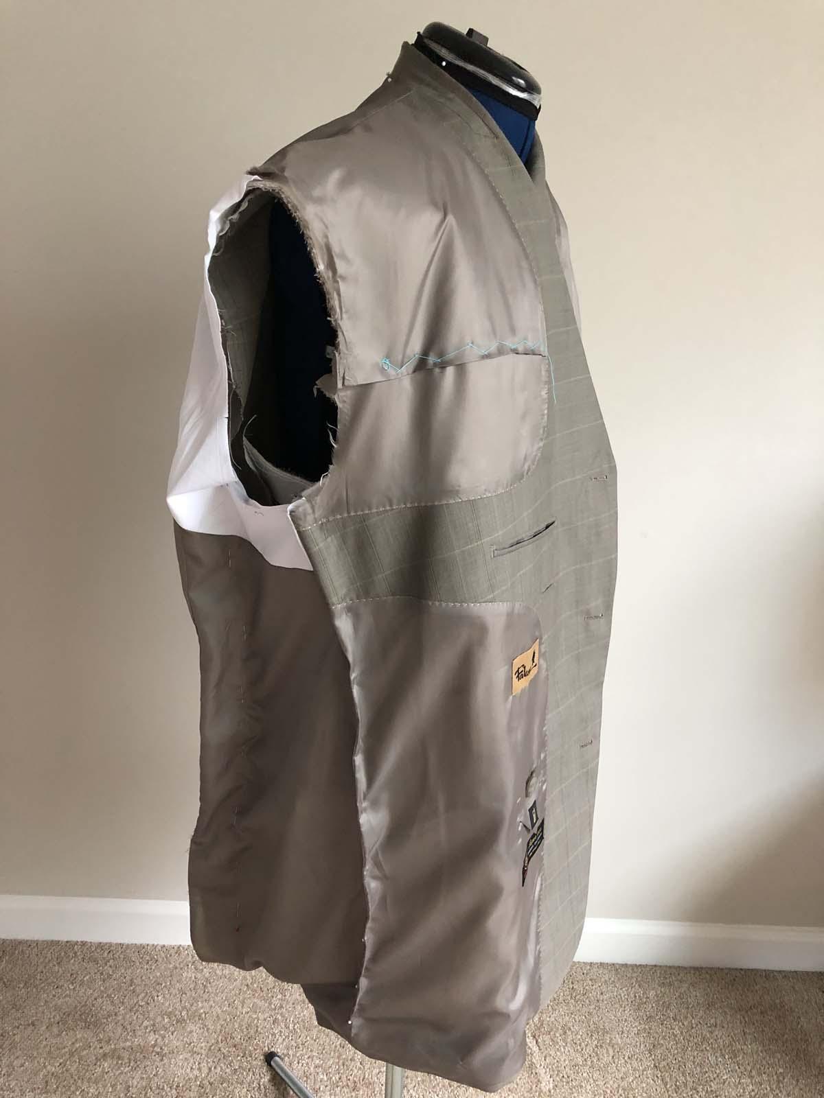 Adjusting the side-front dart on the men's suit jacket