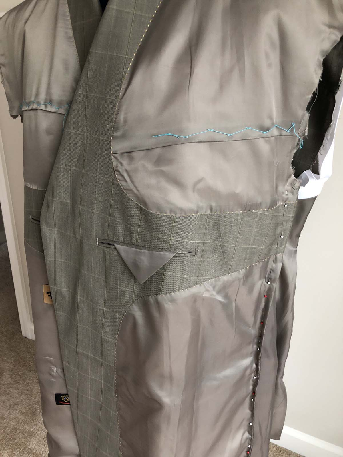 Close-up of other front suit jacket lining with beautifully finished pockets