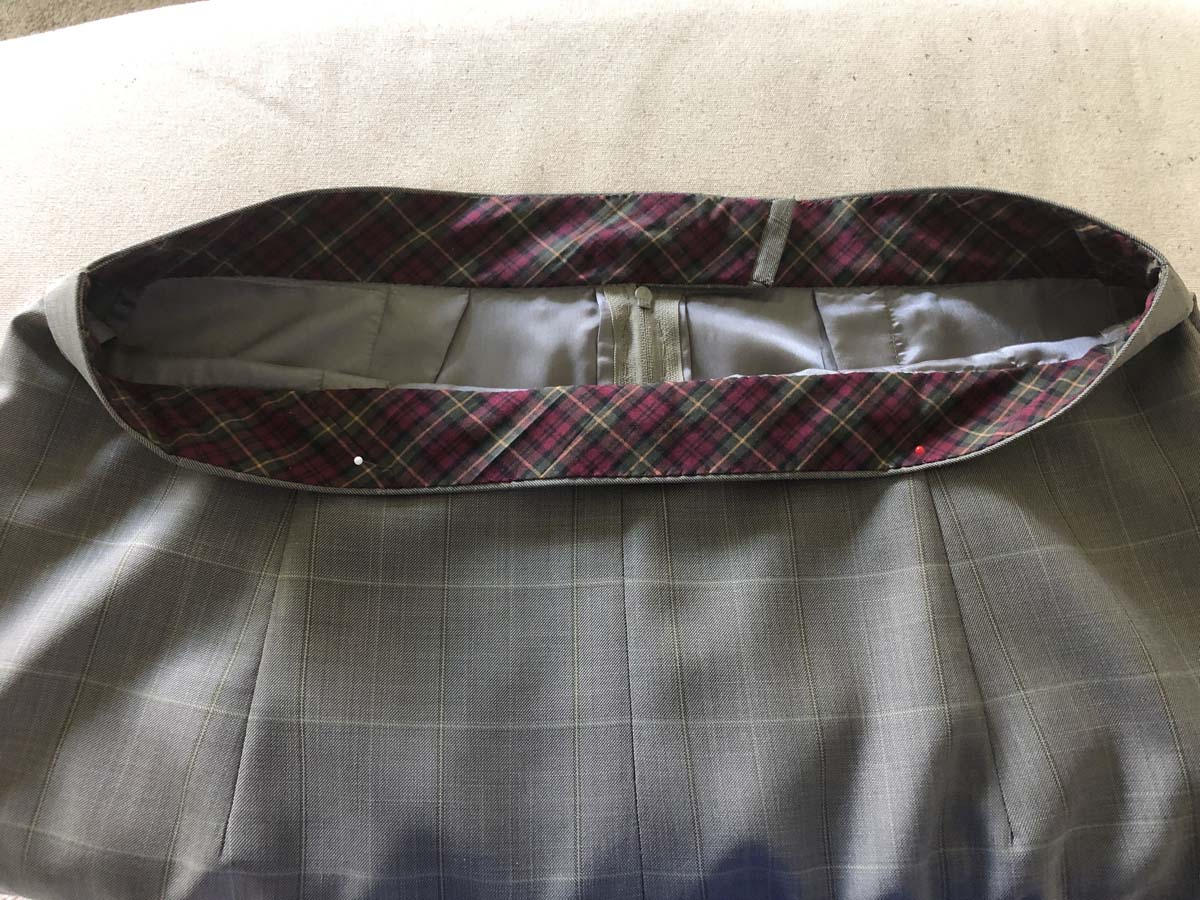 View of finished inner waistband featuring the bias strips cut from the plaid shirt
