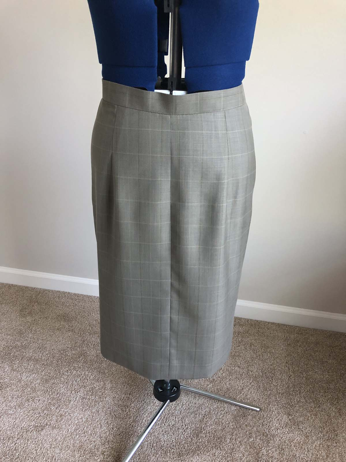 Finished skirt front, on dress form; skirt created from men's suit pants