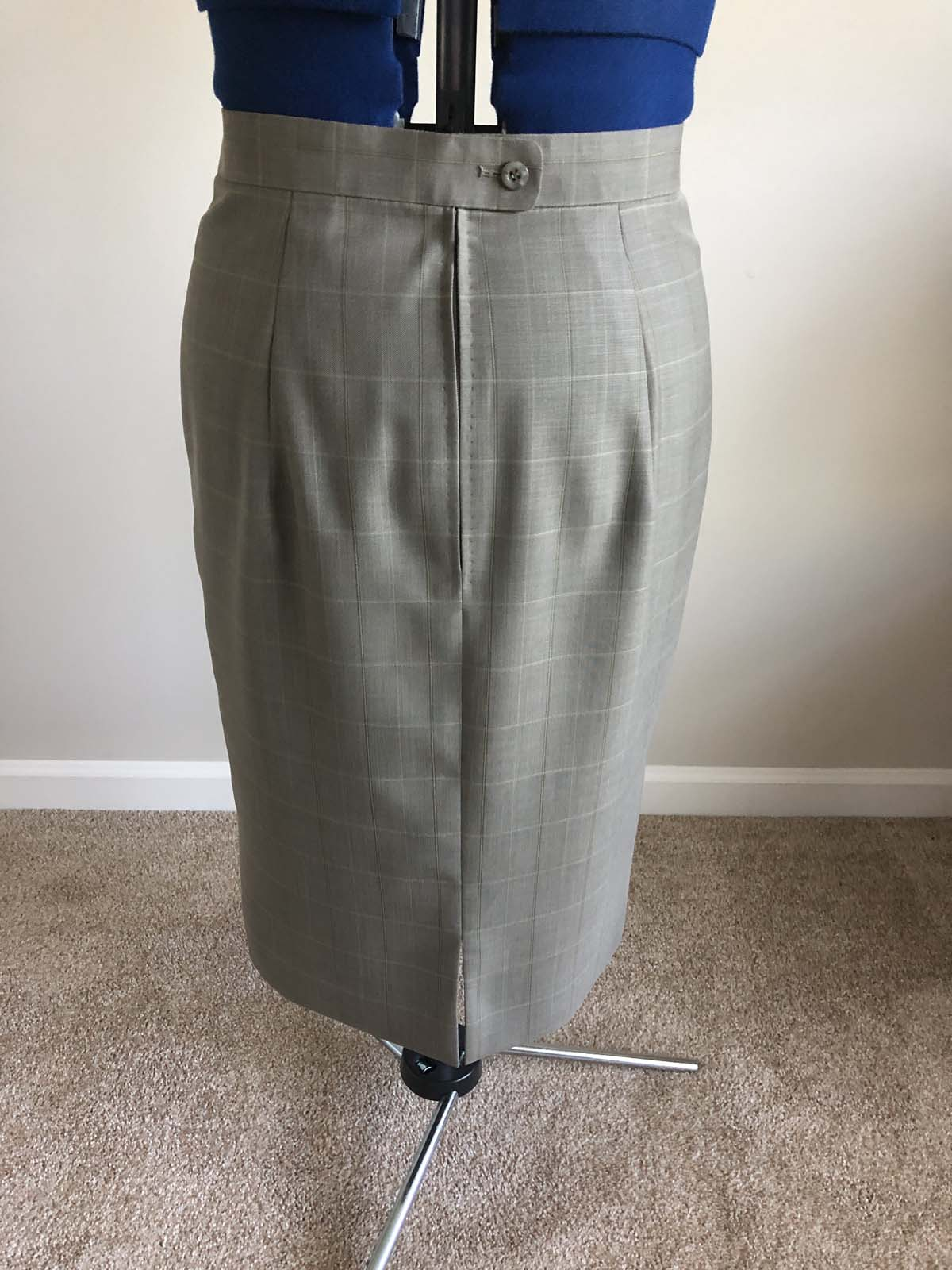 Finished skirt back, on dress form; skirt created from men's suit pants