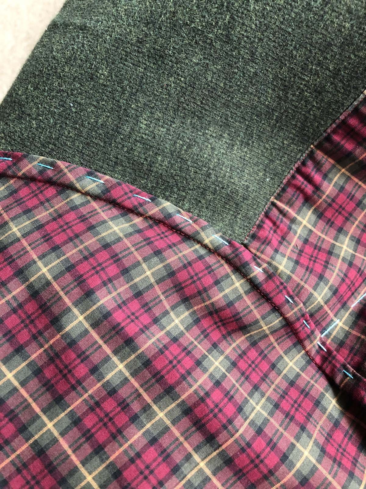 Hand-basted flat-felled seam at the sleeve cap