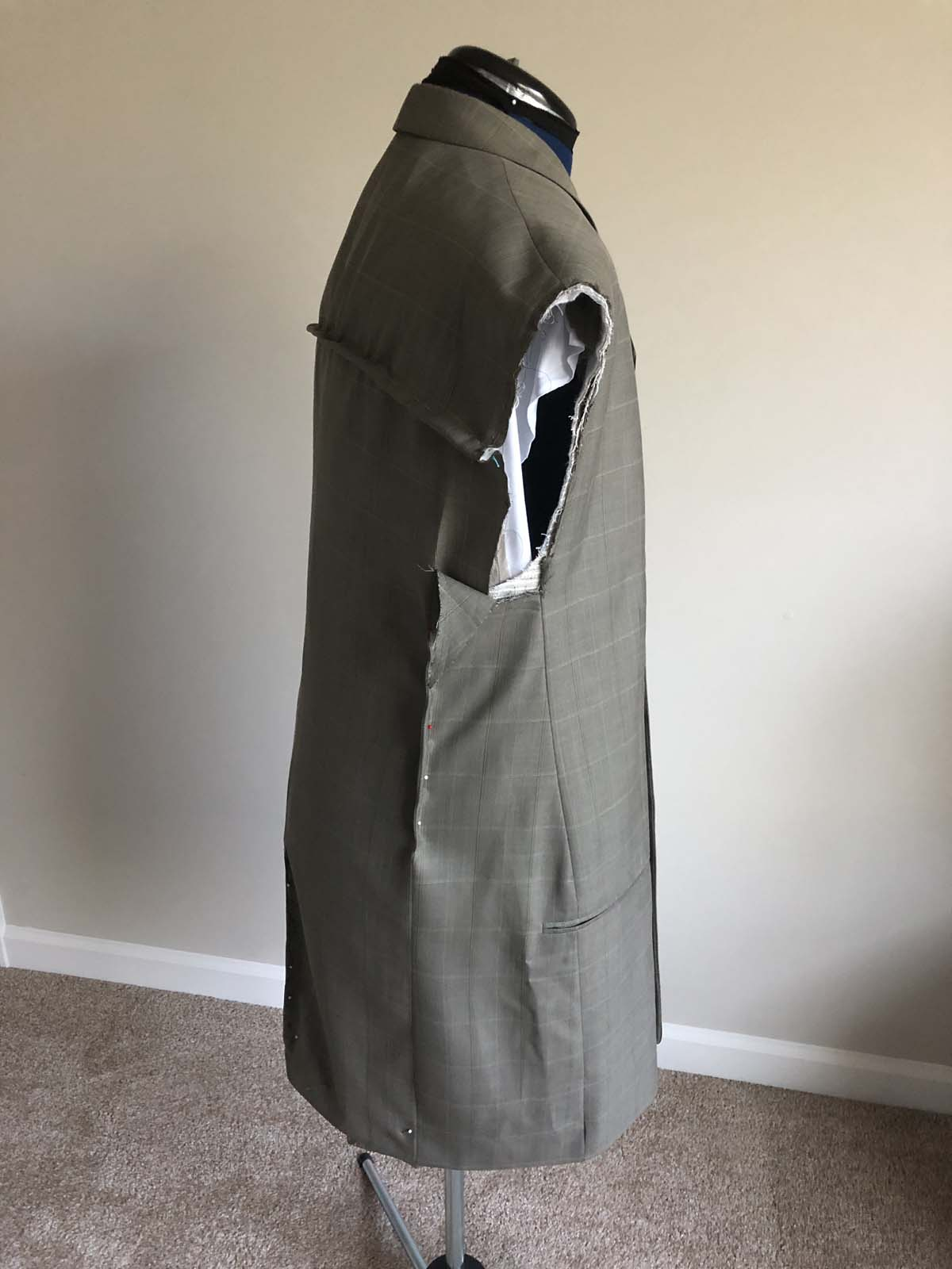 More fitting and draping on the men's suit jacket
