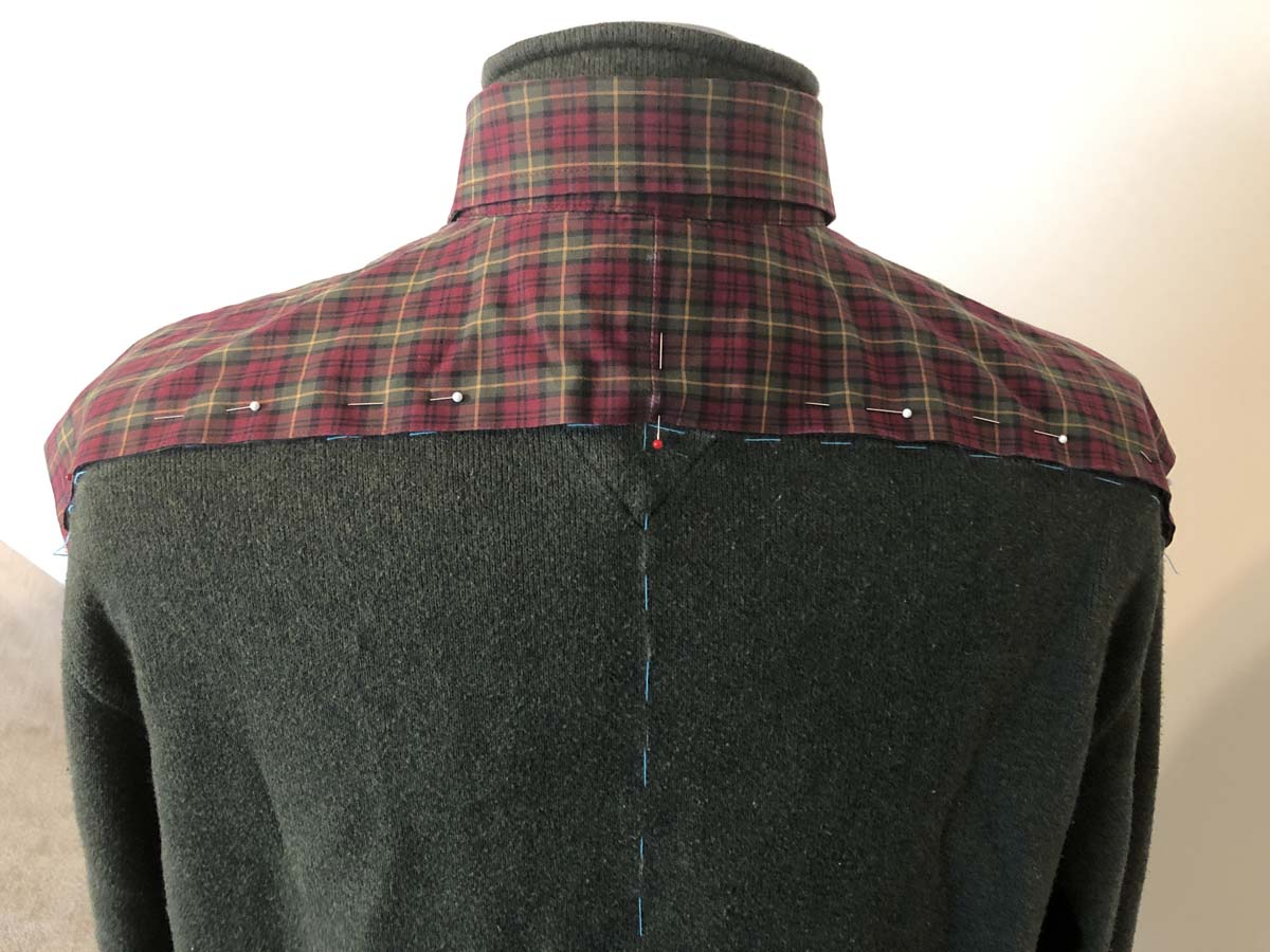 Secure shirt to sweater with pins