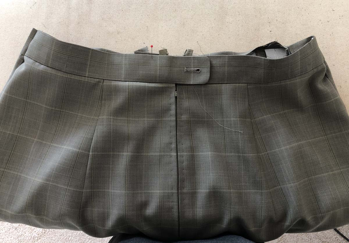 Skirt waistband with hand-picked zipper created from men's suit pants
