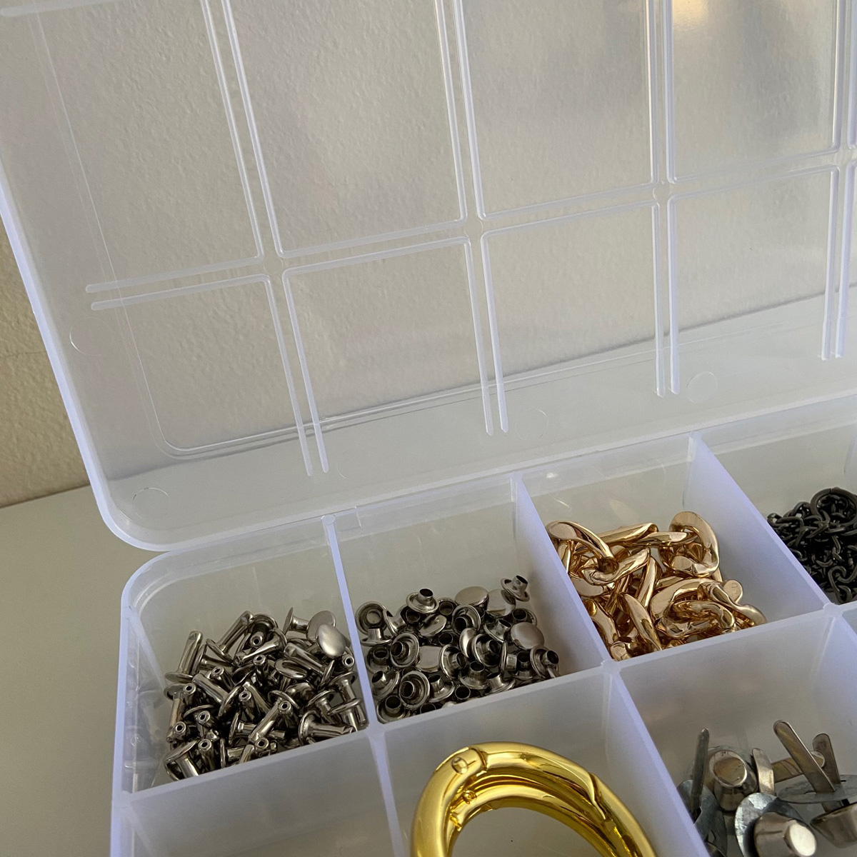 Organization tips: clear plastic storage for small supplies