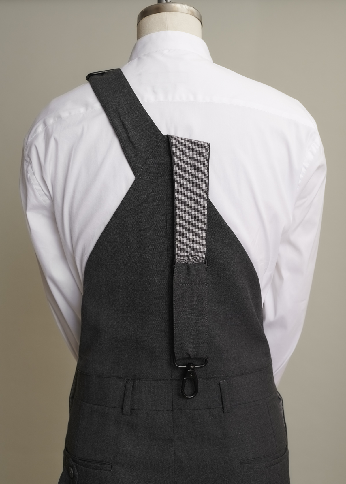 Finished back of overalls with one strap undone