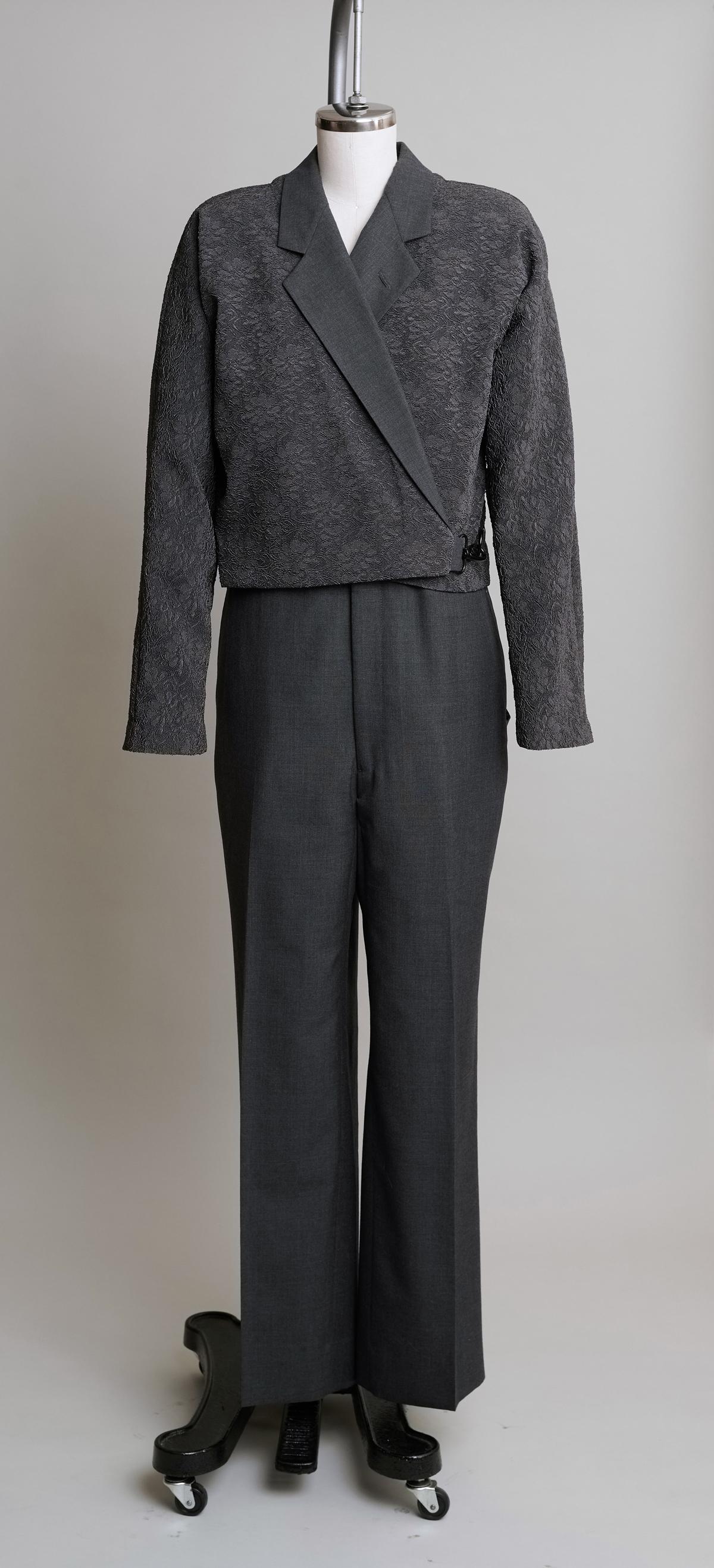 Women's dark pantsuit on dress form