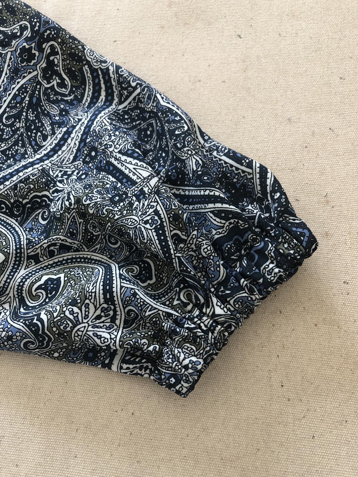 Elastic casing for the blouse sleeve hem