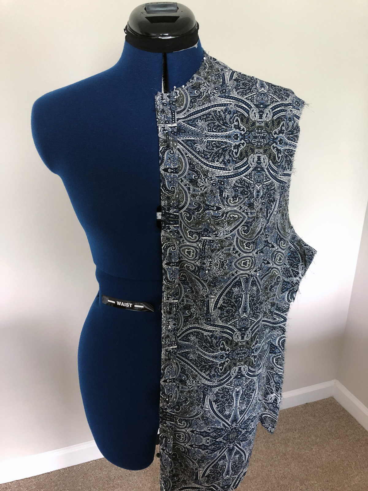 Half blouse front pinned on dress form