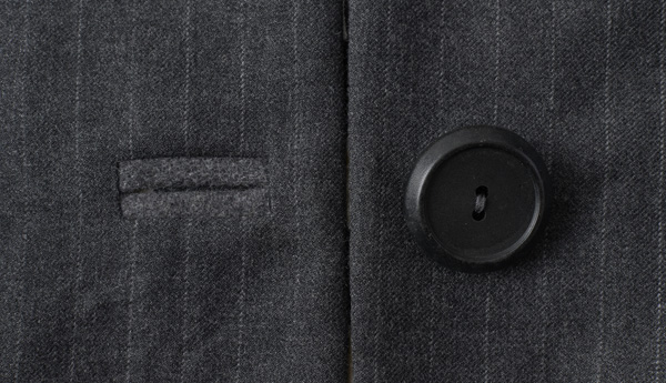 Bound buttonhole and button on woen's suit, made from 1990s men's suit