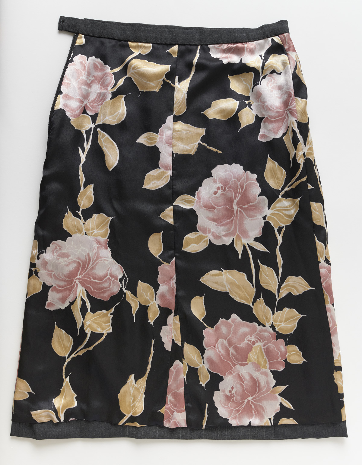 Women's suit skirt turned inside out to show floral charmeuse lining