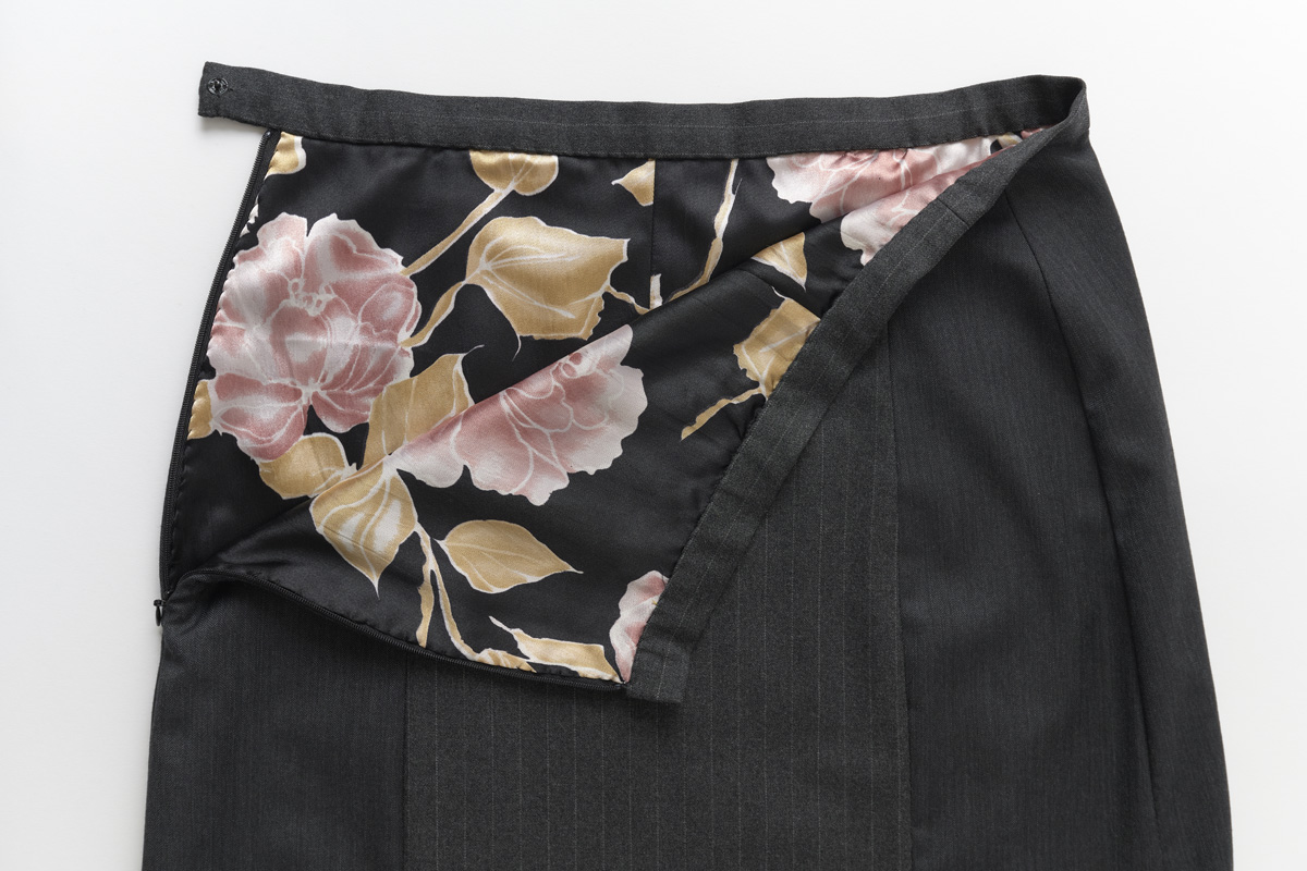 Gray skirt unzipped to show floral lining