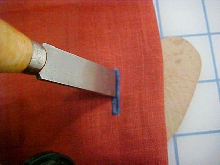 block chisel to open buttonholes
