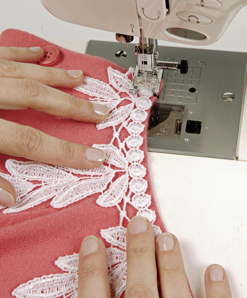 A stitch holds the lace neatly