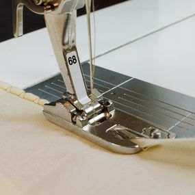 If your decorative stitch aligns with the hem's edges