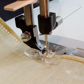 If your decorative stitch doesn't align with the hem folds
