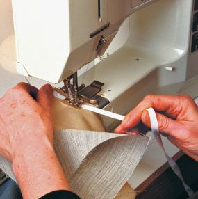 Press the armhole seam allowances