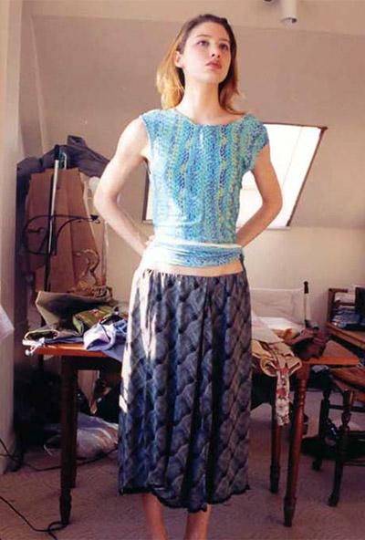 Blue top, purple print skirt