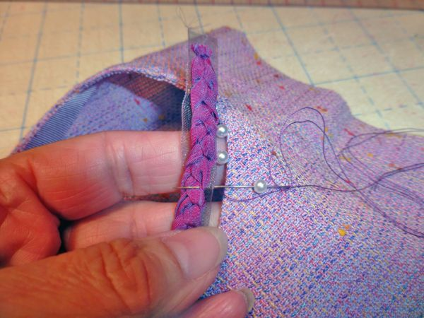 add the braided embellishments to sleeve