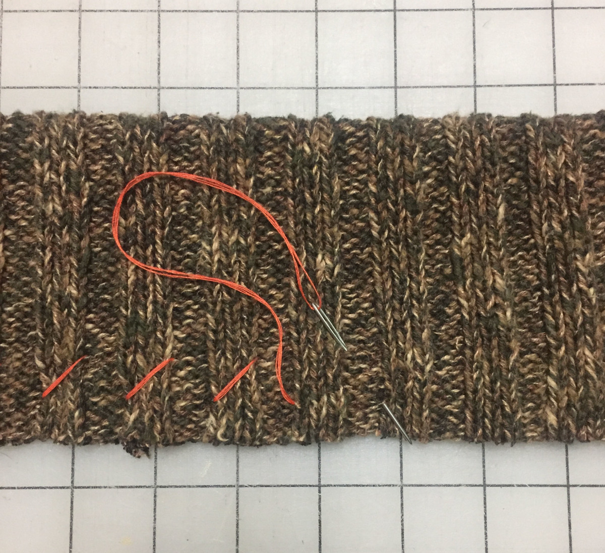Hand-baste along the raw edges of the folded collar