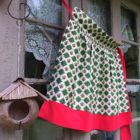 Reversible red apron print side
