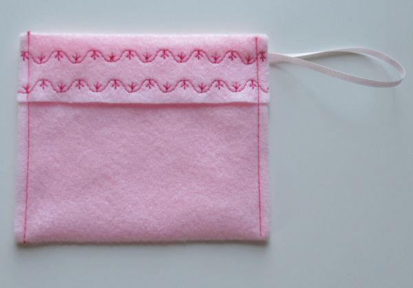 Decoratively stitched top flap