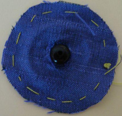 Cut the fabric circle's center a push snap's ball through it